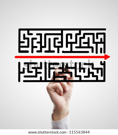 hand drawing labyrinth and red arrow - stock photo