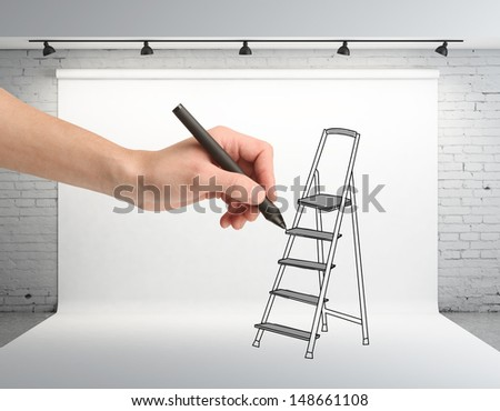 hand drawing ladder on backdrop in room - stock photo