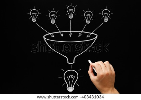 Hand drawing light bulbs and funnel teamwork concept with white chalk on blackboard. Many small ideas add up to a big one. - stock photo