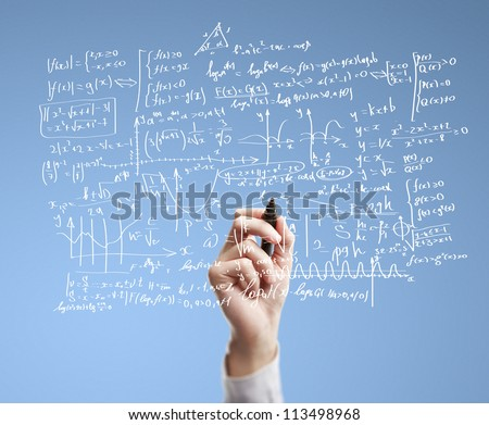 hand drawing mathematical formulas on a board - stock photo