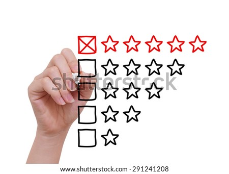 Hand drawing ranking concept with black marker on transparent wipe board. - stock photo
