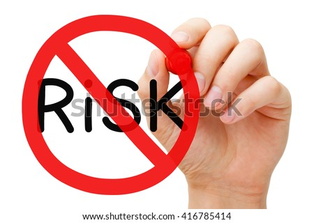 Hand drawing Risk prohibition sign concept with marker on transparent wipe board. Risk-free guarantee concept. - stock photo