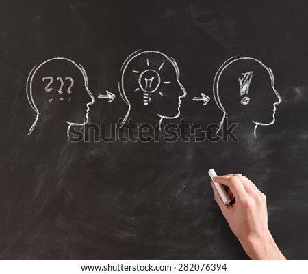 Hand Drawing Silhouettes of Heads with Chalk on Black Board, Concept Image Illustrating Progression of Formation of an Idea in Stages from Confusion to Realization - stock photo