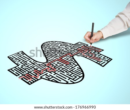 Hand drawing solution route on money shape maze in blue background - stock photo