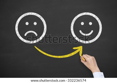 Hand Drawing Unhappy and Happy Smileys on Blackboard - stock photo