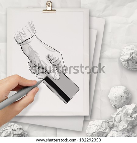 hand drawn hand holding up credit card on book stack background concept  - stock photo