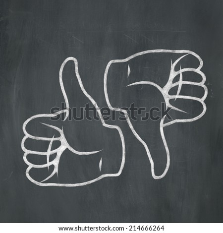 Hand-drawn illustration of a thumbs up and thumbs down in white chalk on a blackboard background. - stock photo
