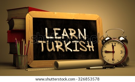 Hand Drawn Learn Turkish Concept  on Chalkboard. Blurred Background. Toned Image. - stock photo