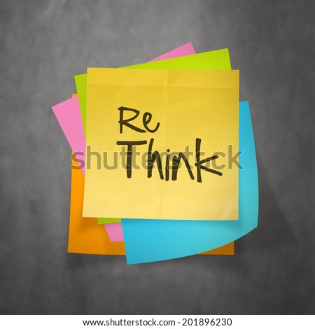 Hand drawn  RETHINK word paper sticky note on texture background as concept