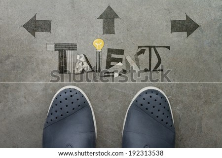 Hand drawn TALENT design word on front of business man feet as concept  - stock photo