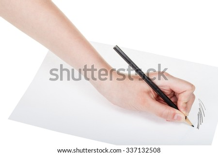 hand draws by wooden black pencil on sheet of paper isolated on white background