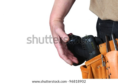 Hand Draws Drill/Close up of waist with suede tool belt, cordless drill & man's hand about to grab the drill as though a gun,clipping path included