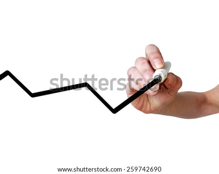 Hand draws graph line with black marker on transparent whiteboard - stock photo