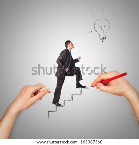 Hand draws stairs with walking businessman on grey background - stock photo