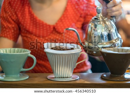 Hand drip coffee, Barista pouring water on coffee ground