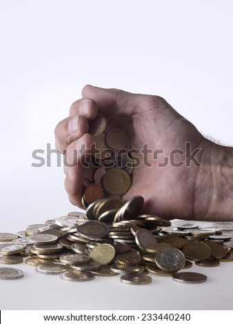 Hand dropping coins - stock photo