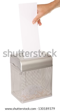 Hand feeding a piece of paper into a document shredder - room for copy. Isolated on white with clipping path.