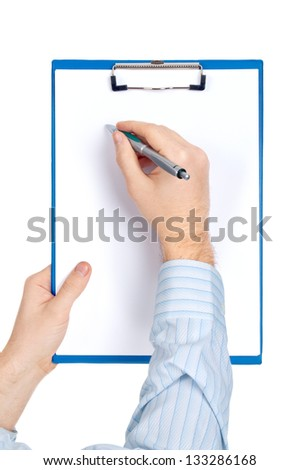 Hand filling out checklist on clipboard with a pen - stock photo