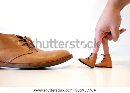 Hand Finger Walking  compare Old Shoe Concept - stock photo