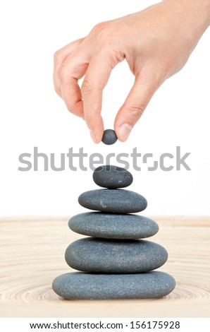 Hand finished stone tower isolated on white  - stock photo
