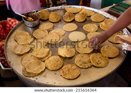 hand flipping tortillas in Mexico - stock photo