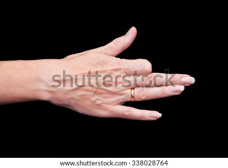 Hand folded in the form of the muzzle of the dog for shadow theater on a black background