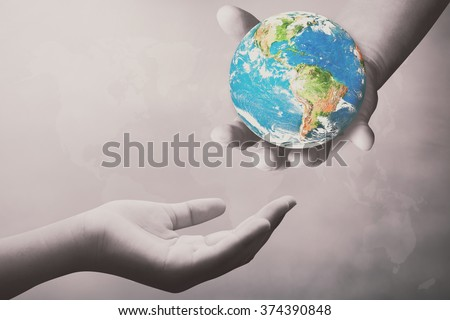 Hand for the opportunity and support. helping misery,wanting to help. Empty female open hand holding. The concept of aid. Open palm hand gesture of female hand:Elements of this image furnished by NASA - stock photo