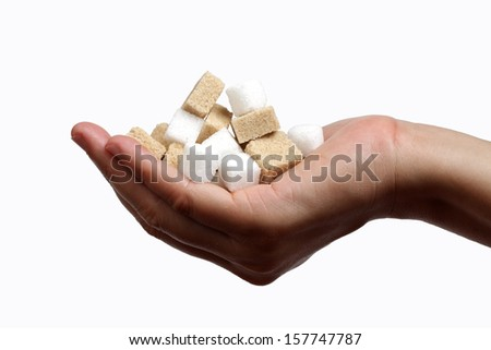 hand full of white sugar cubes isolated on the white background.