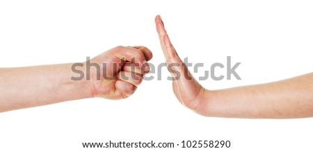 Hand gesture fist against opened hand isolated on white background - stock photo