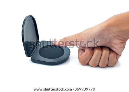 Hand getting ready to use a thumb print ink pad on white background - stock photo