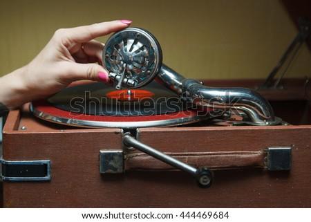 hand girl and gramophone - stock photo