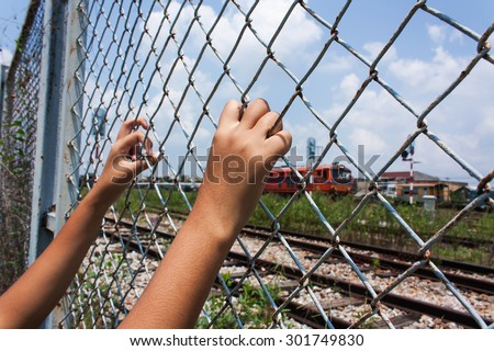 Hand girl in jail at Railway Station - stock photo