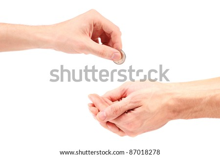 hand gives coin to beggar - stock photo