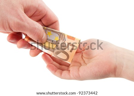 Hand giving a banknote in a hand of a child isolated on a white background - stock photo