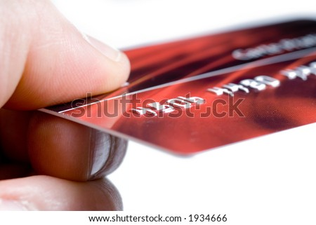hand giving a credit card - stock photo