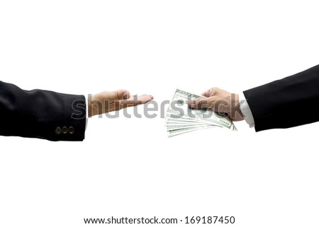 Hand giving cash to another hand - stock photo