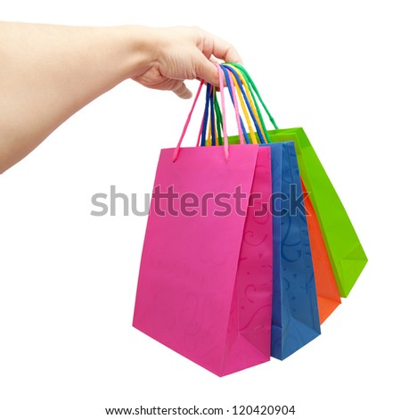 Hand giving colorful paper shopping bags. Isolated on white background