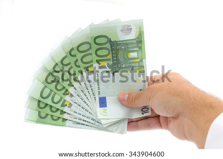 hand giving 100 euro banknotes isolated on white