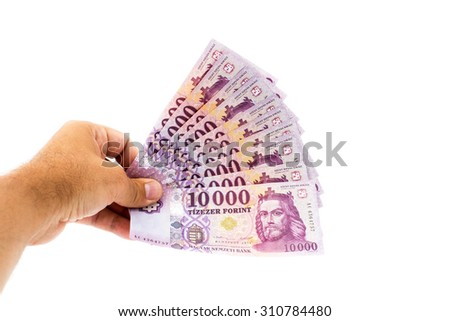 hand giving 10000 forint banknotes isolated isolated on white