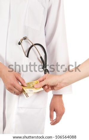 Hand giving money to a doctor. Image taken in front of a white studio background - stock photo