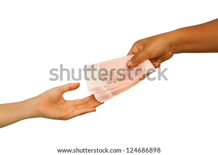 Hand giving money to other hand ,concept business - stock photo