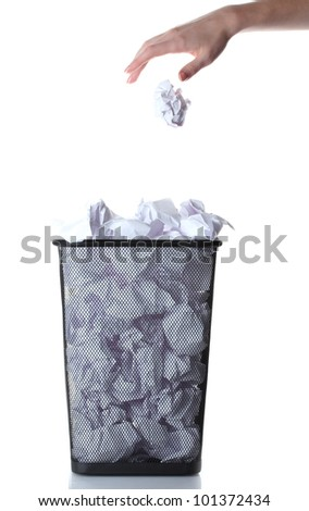 hand going garbage in metal trash bin from paper isolated on white - stock photo