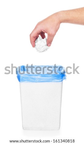 hand going garbage in plastic trash, isolated on white - stock photo