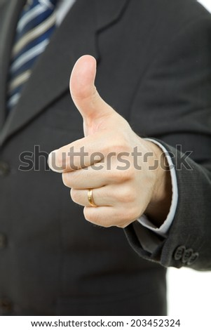 hand going thumb up, business man detail - stock photo