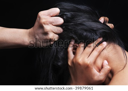 Hand grabbing woman's hair, concept for domestic violence - stock photo