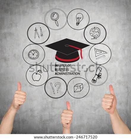 hand graduate giving thumbs up sign - stock photo