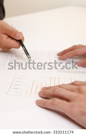 Hand, graph, documents