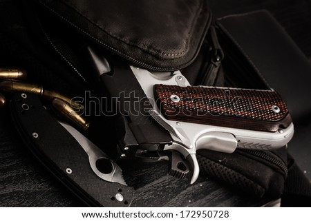hand gun , knife and bullet - stock photo