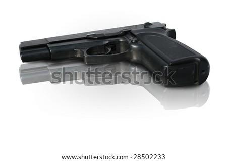 Hand gun or pistol on shiny surface - stock photo