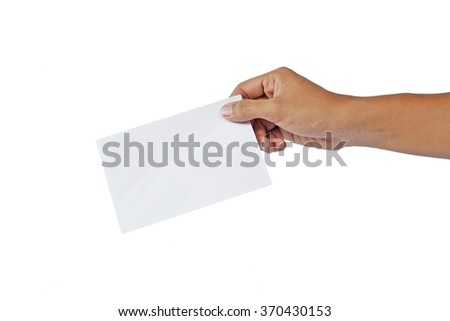 hand handing out a small white envelope. isolated on white background. envelope held by the thumb and index finger